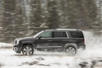 Picture of a driving 2018 GMC Yukon Denali in Onyx Black from a left side perspective