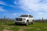 Picture of a 2018 GMC Yukon SLT in Quicksilver Metallic from a front left perspective