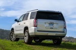 Picture of a 2018 GMC Yukon SLT in Quicksilver Metallic from a rear left perspective