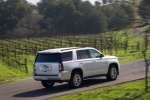 Picture of a driving 2018 GMC Yukon SLT in Quicksilver Metallic from a rear right three-quarter perspective
