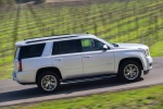 Picture of a driving 2018 GMC Yukon SLT in Quicksilver Metallic from a side perspective