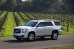 Picture of a driving 2018 GMC Yukon SLT in Quicksilver Metallic from a front left three-quarter perspective