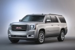 Picture of a 2018 GMC Yukon XL in Quicksilver Metallic from a front left three-quarter perspective
