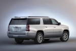 Picture of a 2018 GMC Yukon XL in Quicksilver Metallic from a rear right three-quarter perspective