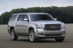 Picture of a 2018 GMC Yukon XL in Quicksilver Metallic from a front right three-quarter perspective