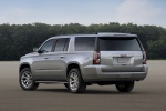 Picture of a 2018 GMC Yukon XL in Quicksilver Metallic from a rear left three-quarter perspective