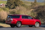 Picture of a 2018 GMC Yukon XL Denali in Red from a rear right three-quarter perspective