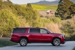 Picture of a 2018 GMC Yukon XL Denali in Red from a side perspective