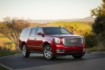 Picture of a 2018 GMC Yukon XL Denali in Red from a front right three-quarter perspective