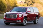 Picture of a 2018 GMC Yukon XL Denali in Red from a front left perspective