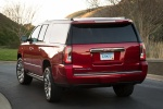 Picture of a 2018 GMC Yukon XL Denali in Red from a rear left perspective
