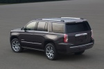 Picture of a 2018 GMC Yukon Denali from a rear left three-quarter perspective