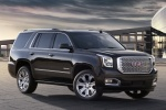 Picture of a 2018 GMC Yukon Denali in Onyx Black from a front right three-quarter perspective