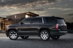 Picture of a 2018 GMC Yukon Denali in Onyx Black from a rear left three-quarter perspective