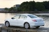 2010 Honda Accord Sedan V6 in White Diamond Pearl from a rear left three-quarter view
