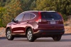 2012 Honda CR-V EX-L AWD in Basque Red Pearl II from a rear left view
