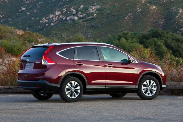 Picture of a 2014 Honda CR-V EX-L AWD in Basque Red Pearl II from a rear right three-quarter perspective