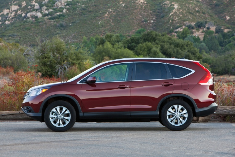 Picture of a 2014 Honda CR-V EX-L AWD in Basque Red Pearl II from a side perspective