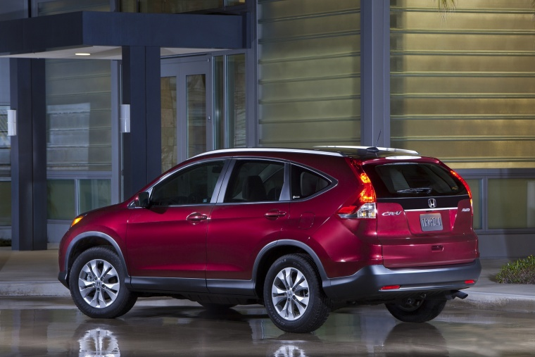 Picture of a 2014 Honda CR-V EX-L AWD in Basque Red Pearl II from a rear left three-quarter perspective