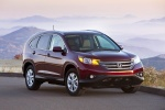 Picture of a 2014 Honda CR-V EX-L AWD in Basque Red Pearl II from a front right perspective