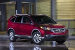 Picture of a 2014 Honda CR-V EX-L AWD in Basque Red Pearl II from a front right three-quarter perspective