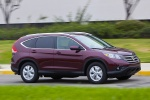 Picture of a driving 2014 Honda CR-V EX-L AWD in Basque Red Pearl II from a front right three-quarter perspective