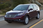 Picture of a driving 2014 Honda CR-V EX-L AWD in Basque Red Pearl II from a front left perspective