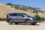 Picture of a 2016 Honda CR-V Touring in Modern Steel Metallic from a side perspective
