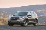 Picture of a 2016 Honda CR-V Touring in Modern Steel Metallic from a front left three-quarter perspective