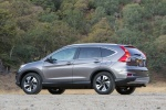 Picture of a 2016 Honda CR-V Touring in Modern Steel Metallic from a rear left three-quarter perspective