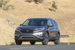 Picture of a driving 2016 Honda CR-V Touring in Modern Steel Metallic from a front left perspective
