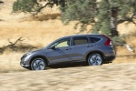 Picture of a driving 2016 Honda CR-V Touring in Modern Steel Metallic from a side perspective