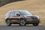 Picture of a 2016 Honda CR-V Touring AWD in Basque Red Pearl II from a front right three-quarter perspective