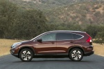 Picture of a 2016 Honda CR-V Touring AWD in Basque Red Pearl II from a side perspective