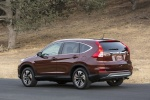 Picture of a 2016 Honda CR-V Touring AWD in Basque Red Pearl II from a rear left three-quarter perspective