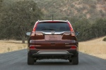 Picture of a 2016 Honda CR-V Touring AWD in Basque Red Pearl II from a rear perspective