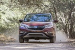 Picture of a driving 2016 Honda CR-V Touring AWD in Basque Red Pearl II from a frontal perspective
