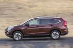 Picture of a driving 2016 Honda CR-V Touring AWD in Basque Red Pearl II from a side perspective