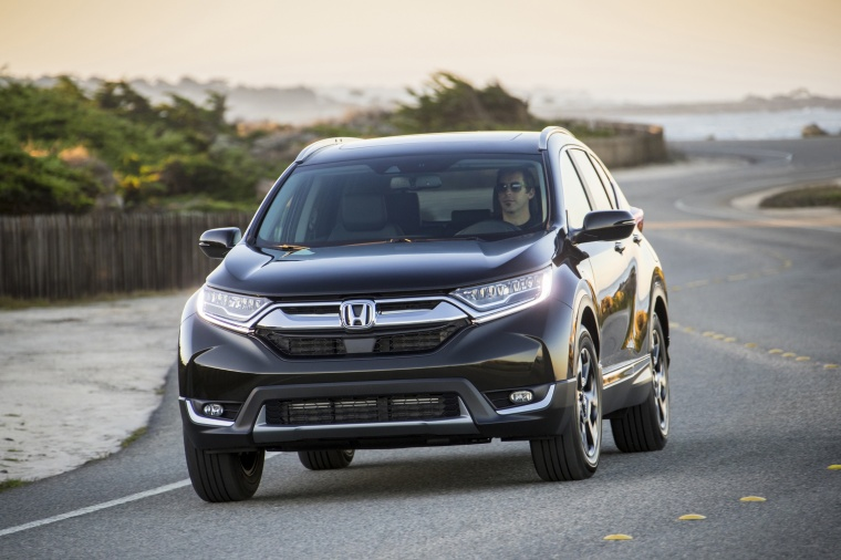 Picture of a driving 2017 Honda CR-V Touring AWD in Crystal Black Pearl from a front left perspective