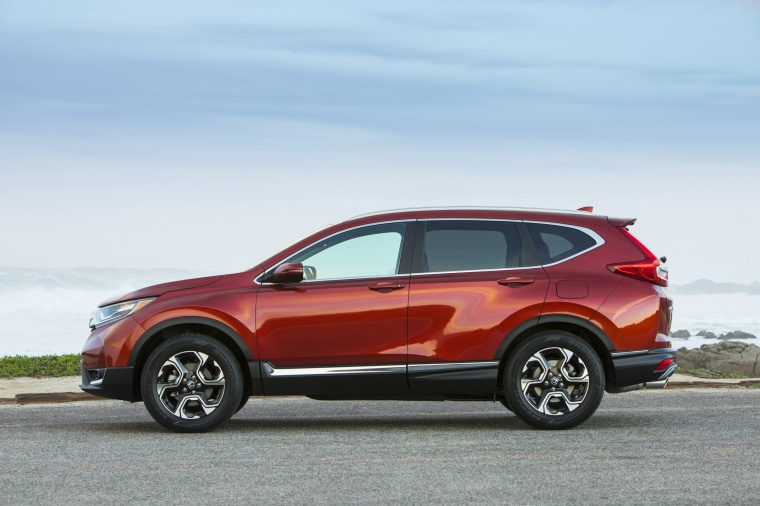 Picture of a 2017 Honda CR-V Touring AWD in Molten Lava Pearl from a side perspective
