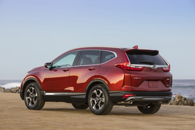 Picture of a 2017 Honda CR-V Touring AWD in Molten Lava Pearl from a rear left perspective
