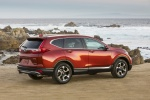 Picture of a 2017 Honda CR-V Touring AWD in Molten Lava Pearl from a rear right three-quarter perspective