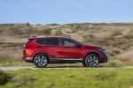 Picture of a driving 2017 Honda CR-V Touring AWD in Molten Lava Pearl from a right side perspective