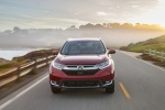 Picture of a driving 2017 Honda CR-V Touring AWD in Molten Lava Pearl from a frontal perspective