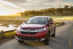 Picture of a driving 2017 Honda CR-V Touring AWD in Molten Lava Pearl from a front left perspective