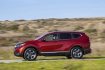 Picture of a driving 2017 Honda CR-V Touring AWD in Molten Lava Pearl from a left side perspective