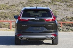 Picture of a 2017 Honda CR-V Touring AWD in Crystal Black Pearl from a rear perspective