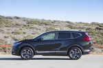 Picture of a 2017 Honda CR-V Touring AWD in Crystal Black Pearl from a side perspective