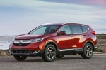 Picture of a 2017 Honda CR-V Touring AWD in Molten Lava Pearl from a front left three-quarter perspective