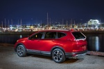 Picture of a 2017 Honda CR-V Touring AWD in Molten Lava Pearl from a rear left three-quarter perspective